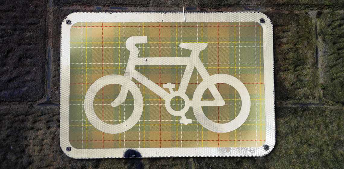 the cycling sign decked out in Weathered Cyclist tartan